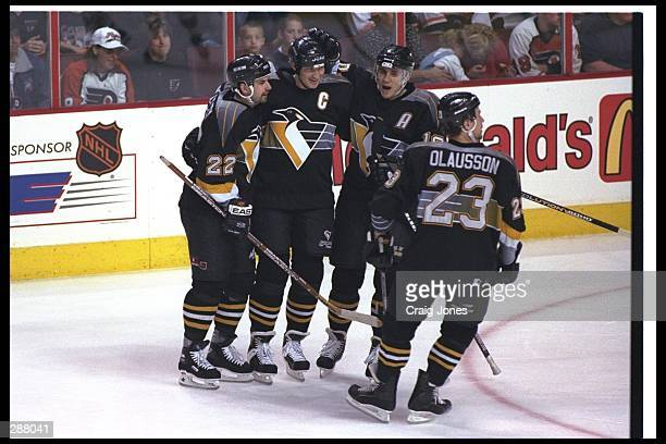 Mario Lemieux of the Pittsburgh Penguins celebrates the last goal of his career with team mates Ron Francis Ron Francis and Fredrik Olausson during...