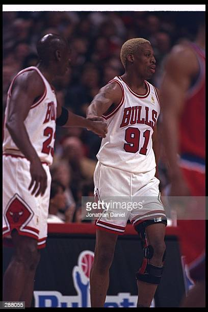 Michael Jordan and Dennis Rodman of the Chicago Bulls hit knuckles during their 9886 win over the Washington Bullets in the NBA first round playoffs...