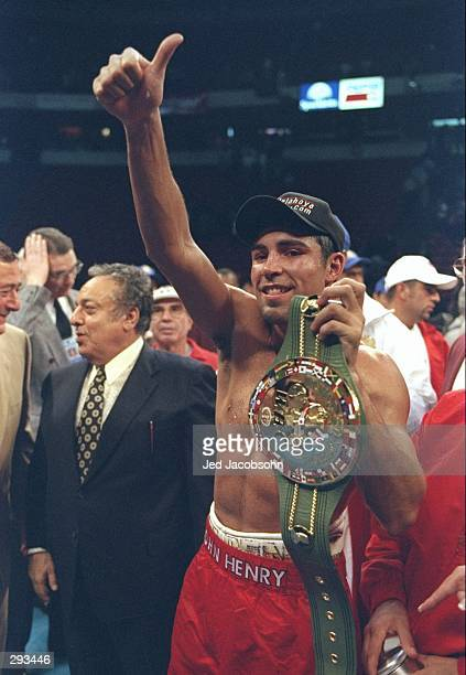 Oscar De La Hoya holds the WBC belt after a fight against Pernell Whitaker at the Thomas and Mack Center in Las Vegas Nevada De La Hoya won the fight...