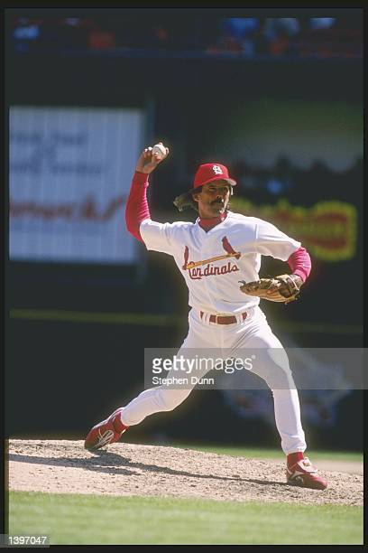 Pitcher Dennis Eckersley of the St Louis Cardinals throws a pitch during a game against the Houston Astros at Busch Stadium in St Louis Missouri The...