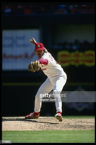 Pitcher Dennis Eckersley of the St Louis Cardinals winds up to throw a pitch during the Cardinals 42 loss to the Houston Astros at Busch Stadium in...