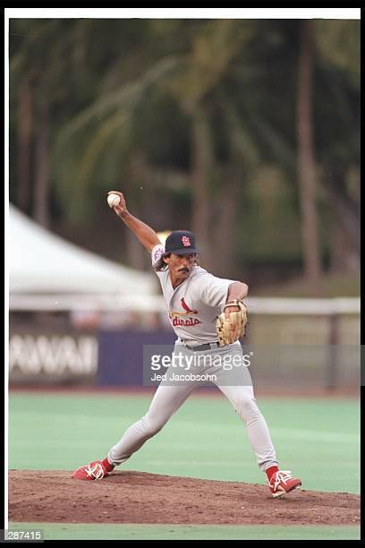 Pitcher Dennis Eckersley of the St Louis Cardinals winds up to throw a pitch during the Cardinals 10 win over the San Diego Padres in an exhibition...
