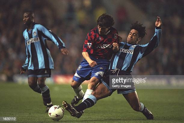 Richard Shaw of Coventry tackles Gianfranco Zola of Chelsea during the Premier League match at Highfield Road in Coventry, England. Coventry won 3-1....