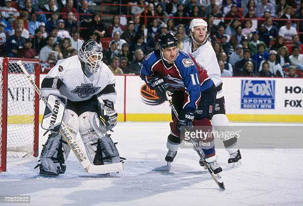 Right wing Keith Jones of the Colorado Avalanche in action as goaltender Jamie Storr of the Los Angeles Kings watches the action during a game at the...