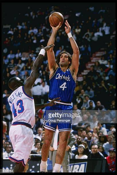 Rony Seikaly of the Orlando Magic shoots over Lorenzo Williams of the Washington Bullets during their 10493 loss to the Bullets at the USAir Arena in...