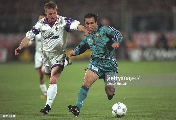 Sergi Barjuan of Barcelona is pursued by Stefan Schwarz of Fiorentina during the European Cup Winners Cup SemiFinal second leg at the Stadio Comunale...
