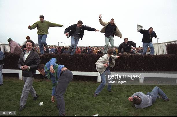 The crowd sieze the opportunity to jump the famous fences at Aintree due to the evacuation of the stands caused by the IRA bomb scare which postponed...