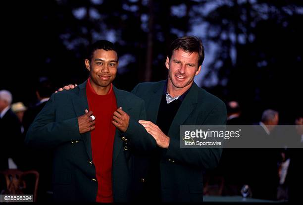 Tiger Woods left is presened the Green Jacket by previous winner Nick Faldo right after Woods won the Masters Tournament at the Augusta National Golf...