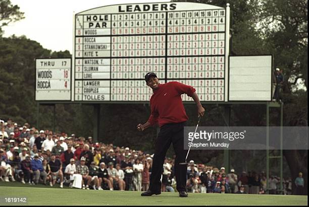 Tiger Woods of the USA celebrates after sinking a 4 feet putt to win the US Masters at Augusta, Georgia. Woods won the tournament with a record low...