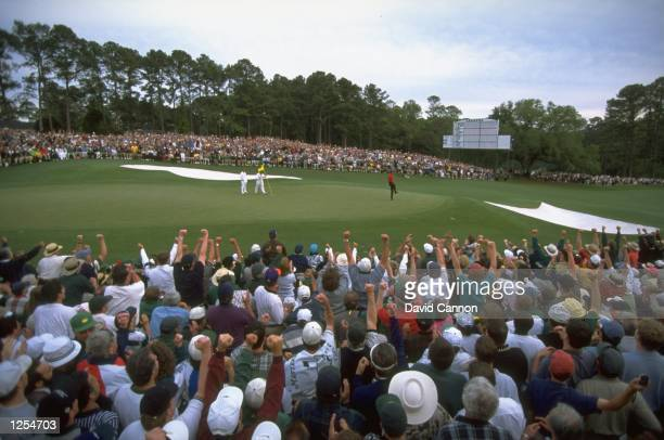 Tiger Woods of the USA sinks his putt on the 18th to win the US Masters at Augusta Georgia Woods won the tournament with a record low score of 18...