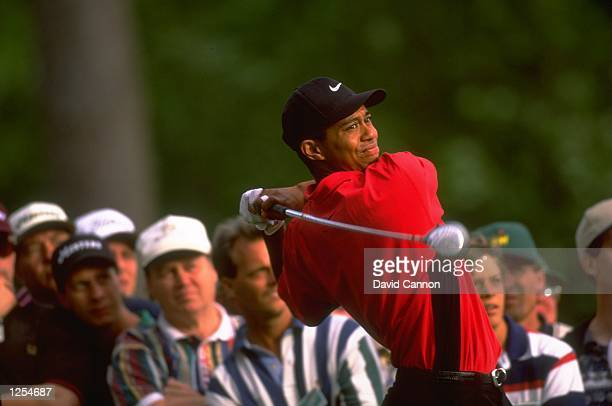 Tiger Woods of the USA tees off at the 15th on the final day of the US Masters at Augusta Georgia Woods went on to win the tournament with a record...