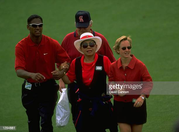 Tiger Woods of the USA with his mother after he won the US Masters at Augusta Georgia Woods won the tournament with a record low score of 270...