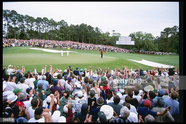 Tigers Woods celebrates his win on the 18th hole at the Masters at the Augusta National Golf Course in Augusta Georgia
