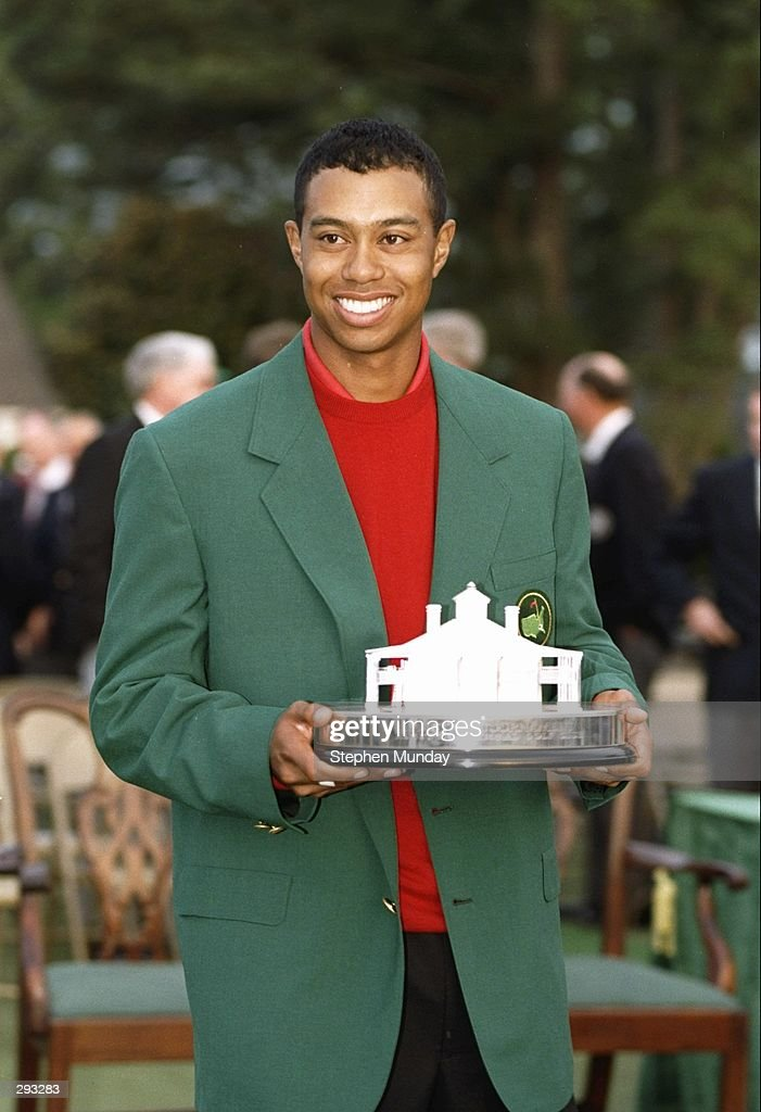 Tigers Woods wears his green jacket and holds his trophy at the Masters Tournament at the Augusta National Golf Course in Augusta, Georgia. Mandatory Credit: Steve Munday /Allsport