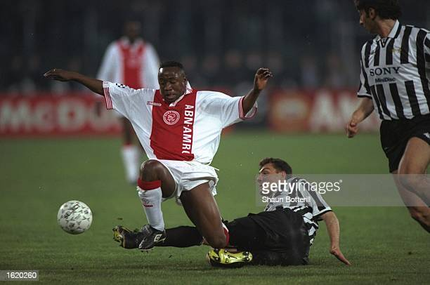 Tijani Babangida of Ajax collides with Christian Vieri of Juventus during the Champions League SemiFinal second leg at the Stadio Della Alpi in Turin...