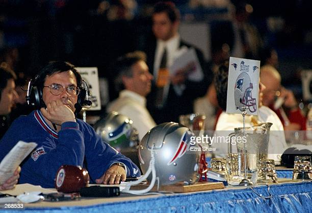 A representative of the New England Patriots looks on during the second day of the 1998 NFL Draft at Madison Square Garden in Manhattan New York...
