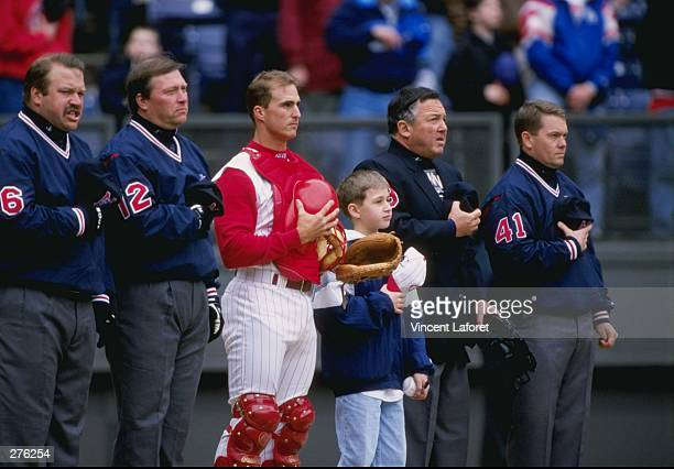 Catcher Brook Fordyce of the Cincinnati Reds stands with the umpire before a game against the Los Angeles Dodgers at Cynergy Field in Cincinnati Ohio...