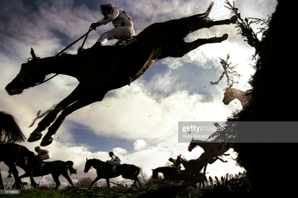 Choisty ridden by Richard McGrath soars over Beechers Brook during the Martell Grand National at Aintree in Liverpool, England. \ Mandatory Credit: Ross Kinnaird /Allsport