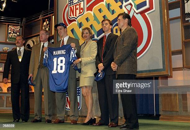 First overall pick Peyton Manning shows off his Jersey alongside his family after being selected by the Indianapolis Colts in the first round of the...