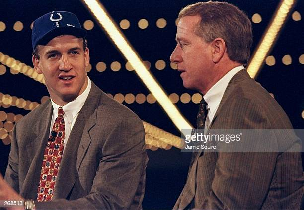 First overall pick Peyton Manning talks with his father Archie Manning after Peyton was selected by the Indianapolis Colts in the first round of the...