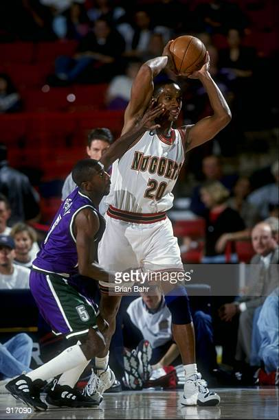 Forward LaPhonso Ellis of the Denver Nuggets in action against the Milwaukee Bucks during a game at the McNichols Sports Arena in Denver Colorado The...