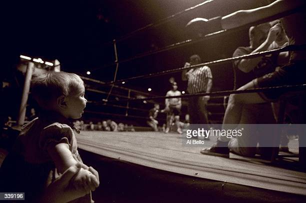 General view of a baby watching the action during the Toughman Contest in Kalamazoo, Michigan. Mandatory Credit: Al Bello /Allsport