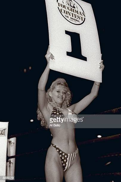 General view of a ring girl holding a placard to announce the first round of competition during the Toughman Contest in Kalamazoo Michigan Mandatory...