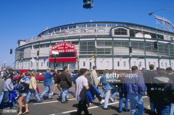 General view of fans going toward the stadium for a game between the Los Angeles Dodgers and the Chicago Cubs at Wrigley Field in Chicago, Illinois....