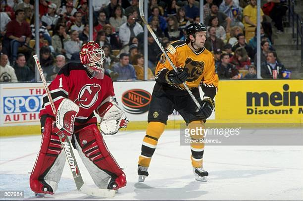 Goaltender Mike Dunham of the New Jersey Devils and center Jason Allison of the Boston Bruins in action during a game at the Fleet Center in Boston,...