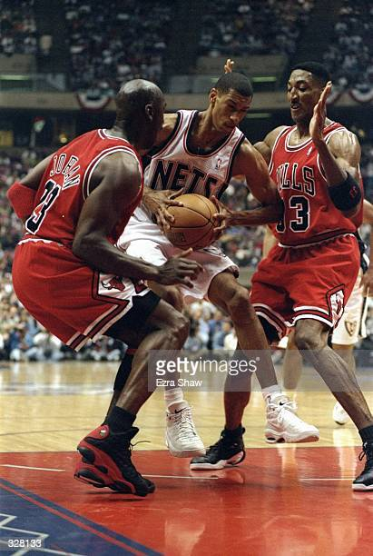 Kerry Kittles of the New Jersey Nets in action against Michael Jordan and Scottie Pippen of the Chicago Bulls during the NBA Playoffs round 3 game at...
