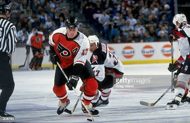 Leftwinger Rod Brind''Amour of the Philadelphia Flyers in action against leftwinger Curtis Brown of the Buffalo Sabres during a game at the Marine...