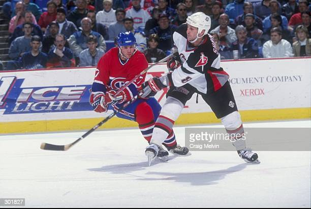 Leftwinger Shayne Corson of the Montreal Canadiens in action against defenseman Darryl Shannon of the Buffalo Sabres during a game at the Marine...