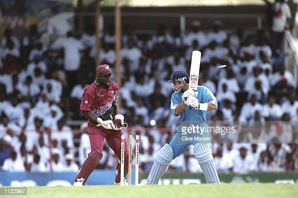Mark Ramprakash of England is bowled during the third One Day International at Arnos Vale in Kingstown St Vincent Ramprakash was bowled Hooper for 1...