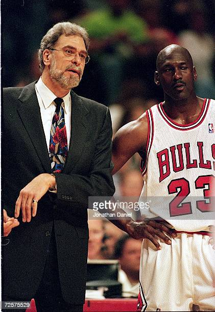 Michael Jordan of the Chicago Bulls listen to Head Coach Phil Jackson during a game against the Indian Pacers at the United Center in Chicago,...