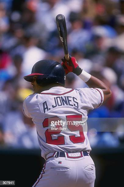 Outfielder Andruw Jones of the Atlanta Braves in action during a game against the Colorado Rockies at Coors Field in Denver Colorado The Braves...