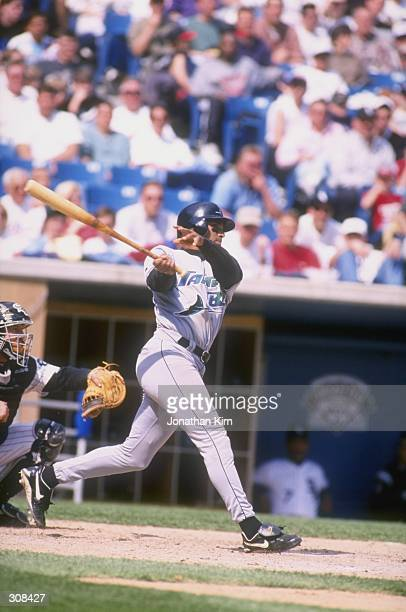 Outfielder Dave Martinez of the Tampa Bay Devil Rays in action during a game against the Chicago White Sox at Comiskey Park in Chicago Illinois The...