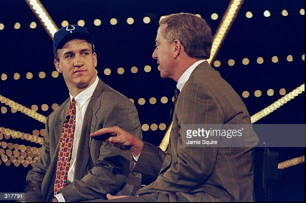 Quarterback Peyton Manning talks to his father Archie Manning during the NFL draft at Madison Square Garden in New York City New York Mandatory...