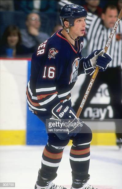 Right wing Kelly Buchberger of the Edmonton Oilers in action during a game against the Calgary Flames at the Saddledome in Calgary Canada The Oilers...