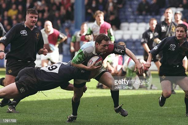 Rob Liley of Harlequins is tackled by Gareth Rees of Wasps during the Allied Dunbar Premiership One match at Loftus Road in London Wasps won the...