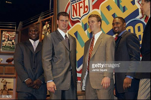 Running back Curtis Enis defensive back Charles Woodson and quarterbacks Ryan Leaf and Peyton Manning stand together during the NFL draft at Madison...