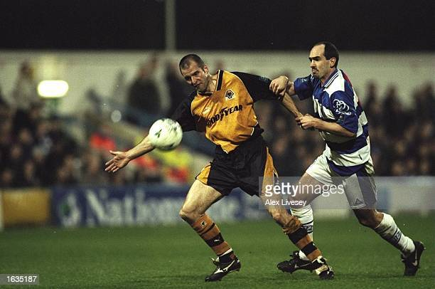 Steve Bull of Wolves fends off a tackle from a QPR player during a match played between Queens Park Rangers and Wolverhampton Wanderers in a...