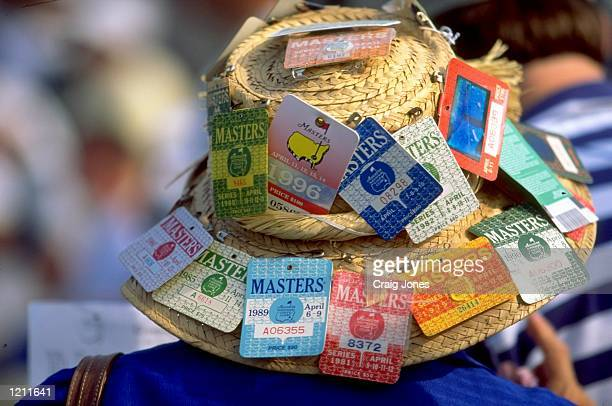 A masters fans displays the past entry tickets of the Masters on his hat during the 1999 US Masters at the Augusta National GC in Augusta Georgia USA...
