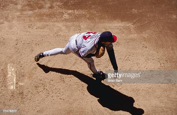 Above view of Pitcher Tom Glavine of the Atlanta Braves as he pitches the ball during the game against the Colorado Rockies at the Coors Stadium in...