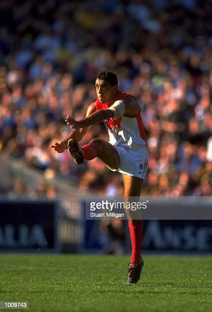 Adam Goodes of the Sydney Swans kicks the ball up field during the Round 2 AFL Football match against Richmond played at the MCG in Melbourne...