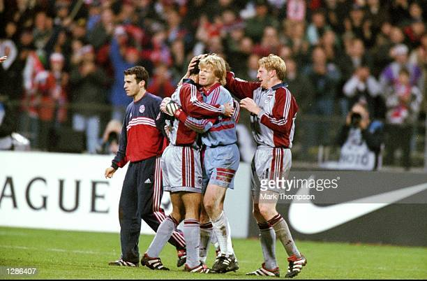 Ali Daei Oliver Kahn and Stefan Effenberg of Bayern Munich celebrate victory in the UEFA Champions League semifinal second leg match against Dynamo...