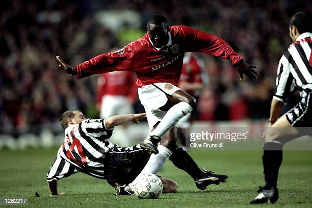 Andy Cole of Manchester United gets past Gianluca Pessotto of Juventus in the UEFA Champions League semifinal first leg match at Old Trafford in...