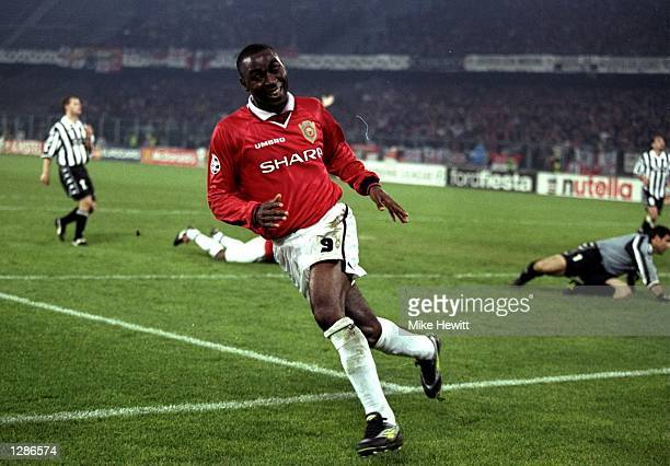 Andy Cole of Manchester United wheels away in delight after scoring the winner in the UEFA Champions League semifinal second leg match against...