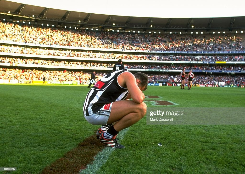 Anthony Rocca of the Collingwood Magpies crouches at a break in play during the AFL Premiership Round 5 match against the Essendon Bombers at the MCG, Melbourne, Australia. The Anzac Day game finished with Essendon (108) defeating Collingwood (100). \ Mandatory Credit: Mark Dadswell /Allsport