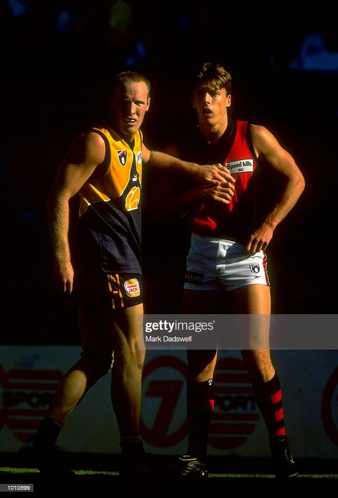 Ashley McIntosh of the West Coast Eagles holds off Matthew Lloyd of the Essendon Bombers during the 1999 AFL Premiership Round 4 match, where the West Coast (97) defeated Essendon (23) at the Subiaco Oval, Perth, Australia. \ Mandatory Credit: Mark Dadswell /Allsport