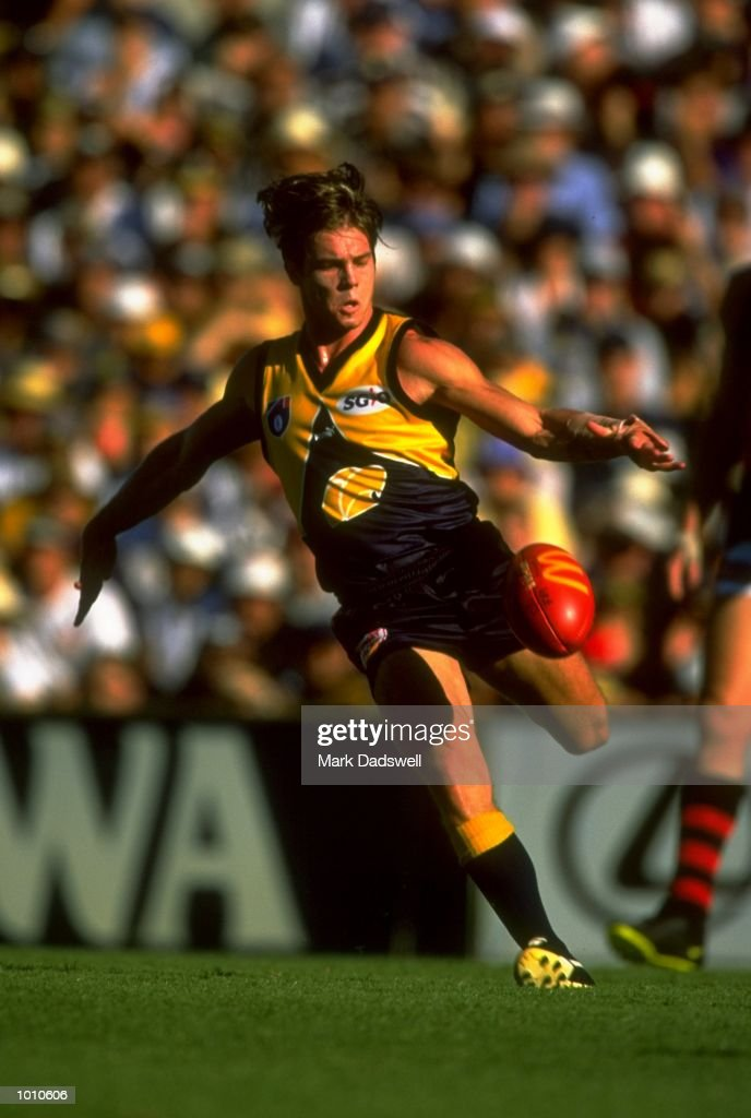 Ben Cousins of the West Coast Eagles in action during the 1999 AFL Premiership Round 4 match, where the West Coast (97) defeated Essendon (23) at the Subiaco Oval, Perth, Australia. \ Mandatory Credit: Mark Dadswell /Allsport
